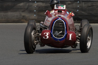 Peter Giddings horses around this Pre-WWII Alfa Romeo Tipo 8C-35 from the Golden Age of Grand Prix Racing. [Sports Car Digest image by Dennis Gray]