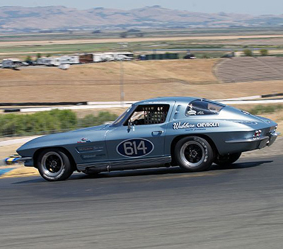 Bob Earle hustles his '63 Split-Window Vette through the top of the circuit. Corvette in its 60th year was the Festival's featured marque. [Sports Car Digest image by Dennis Gray]