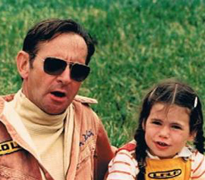 Chuck at the track with his daughter. [Dietrich family image]