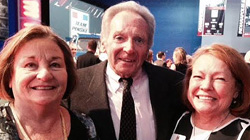 Bill Alsup getting a squeeze from Margaret Hobbs and Kim Eiser.