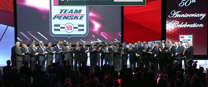 Roger Penske is flanked by 42 of his drivers - past and present. [UTube screen grab]