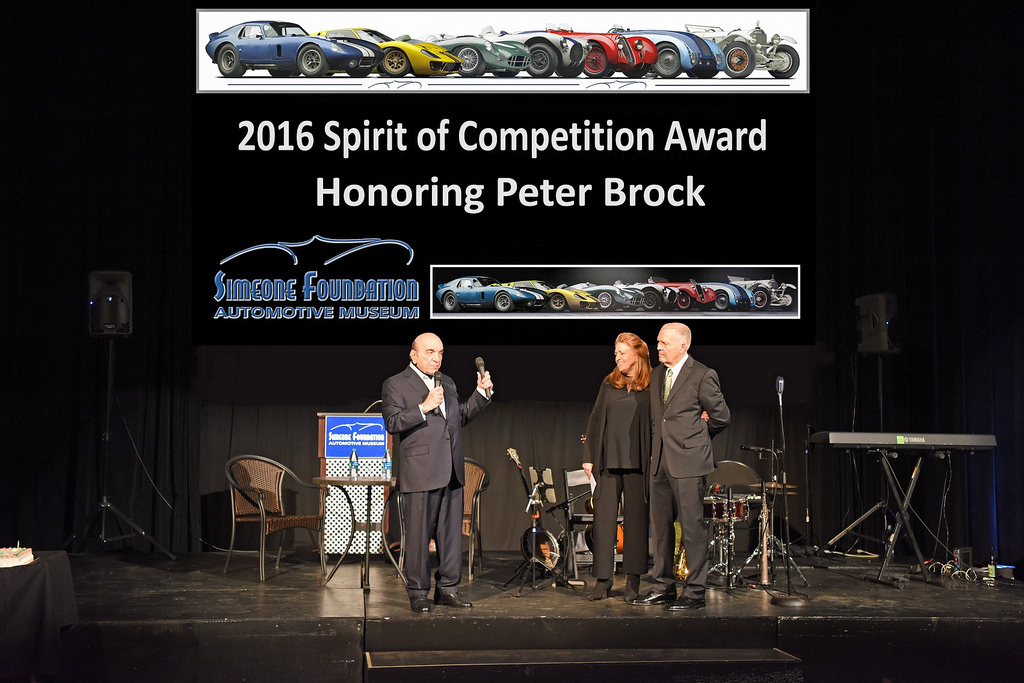 Peter and Gayle Brock are introduced by Dr. Frederick Simeone during the Simeone Foundation's annual fund racing gala Nov. 16. Peter was the 2016 recipient of the Simeone Foundation Automotive Museum's Spirit of Competition Award.