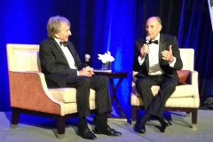 In a format popularized by RRDC President Bobby Rahal, host Derek Bell interviews 2016 Honoree Hans Stuck (right).