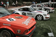 A few of Hans Stuck's racecars: 2002 Jagermeister BMW (foreground), Brumos Porsche, and more.