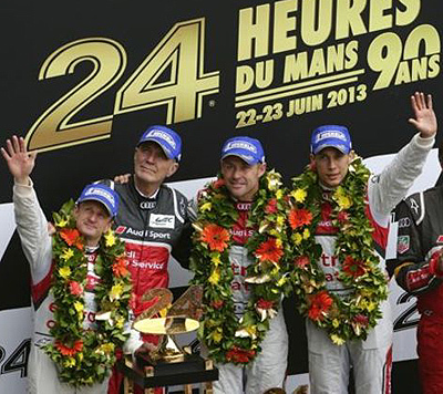 Head of Audi Motorsports Dr. Wolfgang Ulrich (second from left) joins his LeMans winning drivers (l-r) Allan McNish, Tom Kristensen and Loic Duval on the podium.
