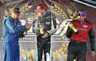 Steve Sargis (right) gets drenched during GT Lite podium celebration [AutoWeek image by Rupert Berrington]