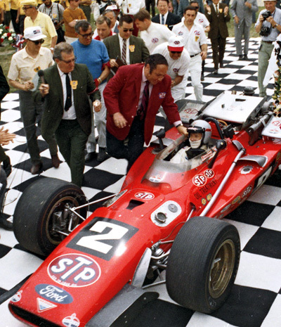 Mario Andretti's lone visit to the Indy 500 victory lane in Andy Granatelli's STP sponsored racecar. [IMS Photo image]