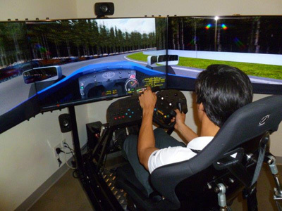 Neil Alberico checks out the Hampton Downs circuit on a CXC Simulator. [Team USA Scholarship image]