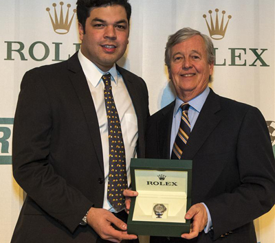 John Stevenson accepts the Bob Snodgrass Award of Excellence - a Rolex - from Bob's son Harris Snodgrass. [Brian Cleary image]