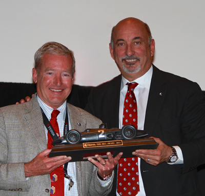 Haywood accepts the Phil Hill Award from RRDC president Bobby Rahal. [Brian Cleary image]