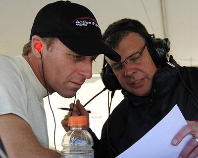 Iain Watt (right) debriefs driver Darren Law during the 2014 Rolex 24 at Daytona. [Darren Law Web site image]