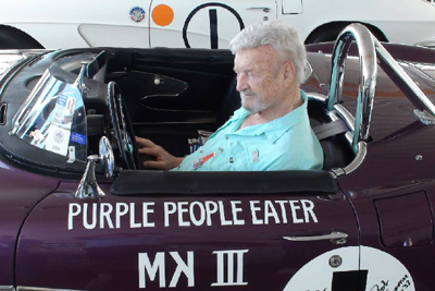 Jeffords reminiscing in his famous Purple People Corvette. [Jim Jeffords Collection image]