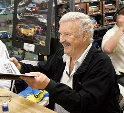 Jeffords signs memorabelia - a most happy fellow. [Jim Jeffords Collection image]