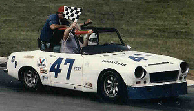 Col. Joe shares a national championship victory lap with his wife Lois and crew chief Bob Ward.
