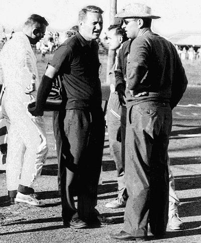 John Bishop did his pro racing due diligence early. Here he picks the great Walt Hansgen's brain at Watkins Glen in 1959.