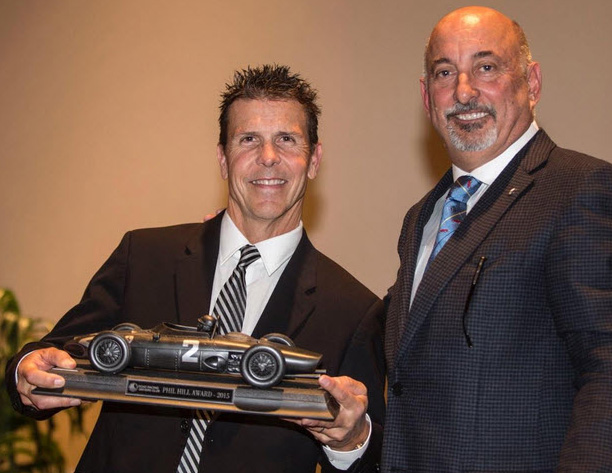 Scott Pruett holds the iconic Phil Hill Award he'd just received from RRDC President Bobby Rahal. [Brian Cleary image]