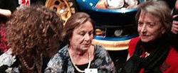 Ellen Griesedieck (Posey), Margaret Hobbs and Gretchen Wintersteen swapping real war stories.