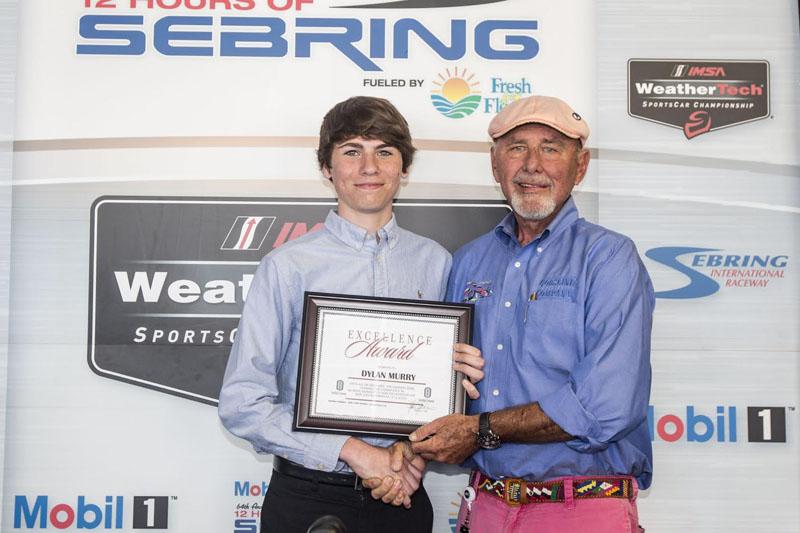 Dylan Murry receives the 2016 Gorsline Scholarship frrom John Gorsline at the 12 Hours of Sebring, Sebring International Raceway, Sebring, FL. [Brian Cleary image]