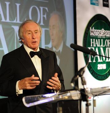 Sir Jackie Stewart announced Dan Gurney's induction. [Motor Sport image]