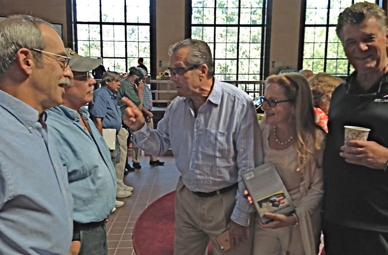 Luigi Chinetti making a point to Rick Bell. Don Breslauer (l), Jacqueline Tardif and Reeves Callaway are taking it all in. [Judy Stropus image]